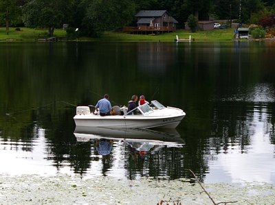 A family of boaters on Black Lake in Olympia, Washington.