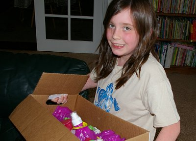 Granddaughter Izzy with a box of Krazy Kritters in Parkland, Washington.